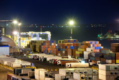 Port warehouse with cargoes and containers Stock Photos