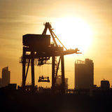 Port warehouse with container cargo and crane bridge Stock Photo