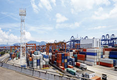 Port warehouse with containers and industrial cargoes Royalty Free Stock Image