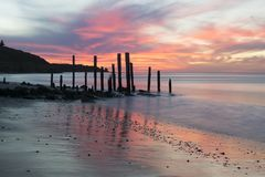 Port Willunga Beach Jetty Ruins at Sunset, South Australia. Port Willunga Beach featuring the iconic jetty ruins. In the Fleurieu Peninsula. Nature at it`s best Stock Photos