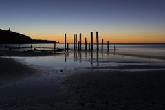Port Willunga Beach, South Australia at sunset. The old jetty ruins on Port Willunga Beach, South Australia at sunset. Known as the sticks by locals and Royalty Free Stock Image