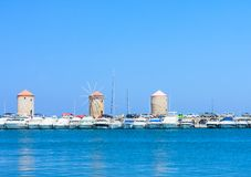 Port and the windmills on the island of Rhodes, Greece Royalty Free Stock Photo