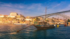Free Port Wine Boats At The Waterfront With Dom Luis Bridge And The Old Town On The Douro River In Ribeira In The City Centre Of Porto Stock Photos - 136740743
