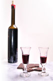 Port wine and chocolate. Bottle and glasses of port dessert wine with chocolate Stock Images