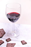 Port wine and chocolate. Glass of port dessert wine with chocolate Royalty Free Stock Photo