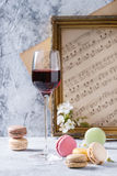 Port wine with french dessert macaroons Royalty Free Stock Image