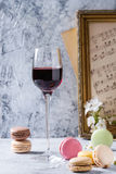 Port wine with french dessert macaroons. Glass of port wine with variety of colorful french dessert macaron macaroons with different fillings served with spring Stock Photos