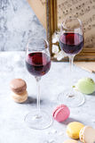Port wine with french dessert macaroons Royalty Free Stock Photos