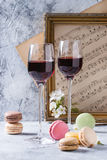 Port wine with french dessert macaroons Royalty Free Stock Photo