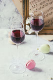 Port wine with french dessert macaroons Royalty Free Stock Photography