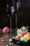 Port wine with french dessert macaroons Stock Photography