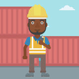 Port worker talking on wireless radio. Stock Images