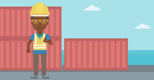 Port worker talking on wireless radio. Royalty Free Stock Images
