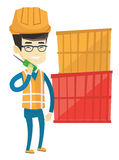 Port worker talking on wireless radio. Royalty Free Stock Photography