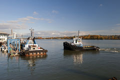 Port and a working boat Royalty Free Stock Photos
