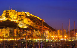 Port with yachts against Castle in night. Alicante, Spain Royalty Free Stock Photo