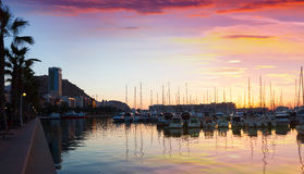Port with yachts and embankment in dawn. Alicante Royalty Free Stock Photo