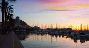 Port with yachts and embankment in sunrise. Alicante. View of Port with yachts and embankment in sunrise. Alicante, Spain Stock Photo
