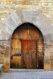 Porta Ainsa medieval de madeira do arco do Romanesque fotografia de stock