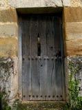Porta antica di una foglia di legno scura 1 fotografia stock