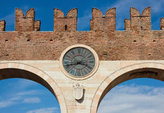 Porta Bra in Verona. Porta Bra is the entrance to piazza Bra in Verona, Italy. Detail shot of the arches over bright blue sky Stock Photo