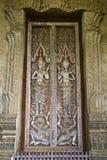 Porta buddista della chiesa di stile tradizionale del laotiano Fotografie Stock Libere da Diritti