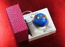 Porta-chaves do Glob em uma caixa Fotografia de Stock