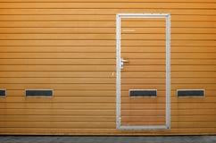 Porta da garagem como o fundo Fotografia de Stock Royalty Free