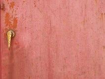 Porta de aço pintada vermelha velha Imagens de Stock Royalty Free
