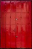 Porta de dobramento vermelha do metal Fotos de Stock