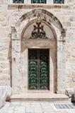 A porta de entrada à parte armênia da igreja do sepulcro santamente no Jerusalém, Israel Fotografia de Stock Royalty Free