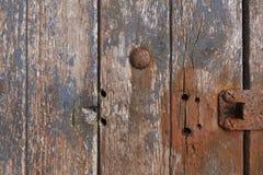 Porta de madeira afligida Imagens de Stock
