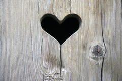 Porta de madeira com coração Fotos de Stock
