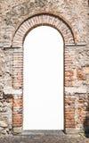 Porta de madeira velha com arcada do tijolo Foto de Stock