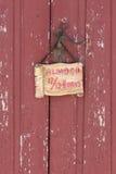 Porta di legno rossa storica Immagine Stock
