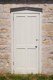 Porta di legno in una costruzione di pietra in Fredericksburg il Texas Immagini Stock Libere da Diritti