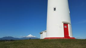 Porta di rosso di Taranaki Nuova Zelanda del faro Immagine Stock