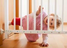Porta do bebê e da escada Imagens de Stock Royalty Free