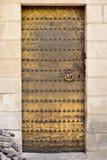 Porta dorata di moresco. Immagine Stock