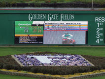 A porta dourada coloca Digitas Scoreboad Fotos de Stock