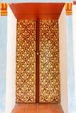 Porta dourada do salão do scripture imagem de stock