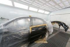 Porta e amortecedor de carro após a pintura Fotografia de Stock Royalty Free