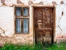 Porta e indicador velhos Imagens de Stock