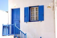 Porta e janela azuis em Mykonos Imagem de Stock Royalty Free