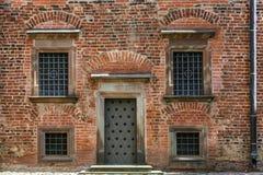 Porta e quattro finestre Immagine Stock