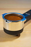 Porta filter with fresh ground coffee ready to brew in the espresso machine stock images