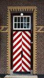 Porta medieval listrada de madeira Fotografia de Stock Royalty Free