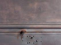 Porta metallica del garage di struttura grigio scuro del fondo Fotografia Stock