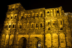 Porta negra in trier at night Stock Photos