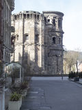 Porta Nigra, Trier. The Porta Nigra is a large Roman city gate in Trier, Germany. It is today the largest Roman city gate north of the Alps. Trier is a city in Stock Photos